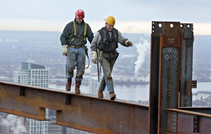 Bendistis, 39, (front) andClarkson, walk an interior beam on the 47th floor.
